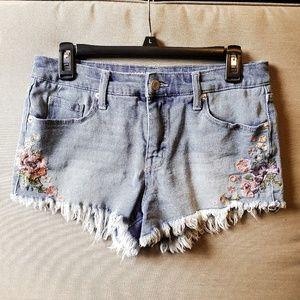 Light wash denim shorts with flower detail